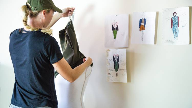 Erin Mathias with her fashion sketches. Photo by Pilar Timpane