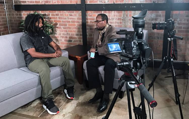 Mark Anthony Neal, right, interviews rapper MURS on