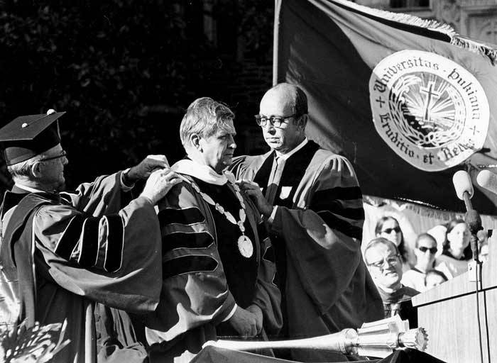 The chain of office is placed on President Terry Sanford, the first time it was used at Duke. Photo: University Archives