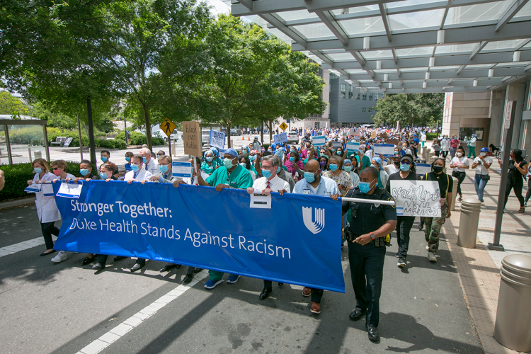 Price, Washington and others lead the marchers through the medical campus.
