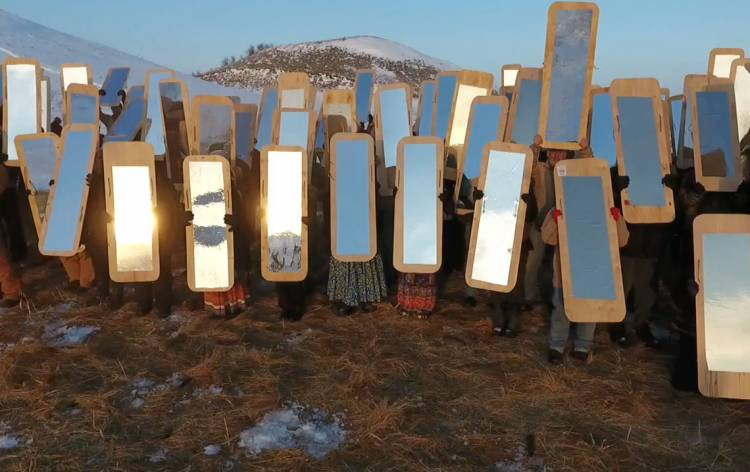 Mirror Shield Project. Conceived by artist Cannupa Hanska Luger. Drone image still by Rory Wakemup. Oceti Sakowin Camp, 2016.