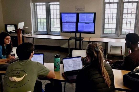 Duke students work on a translation exercise in class