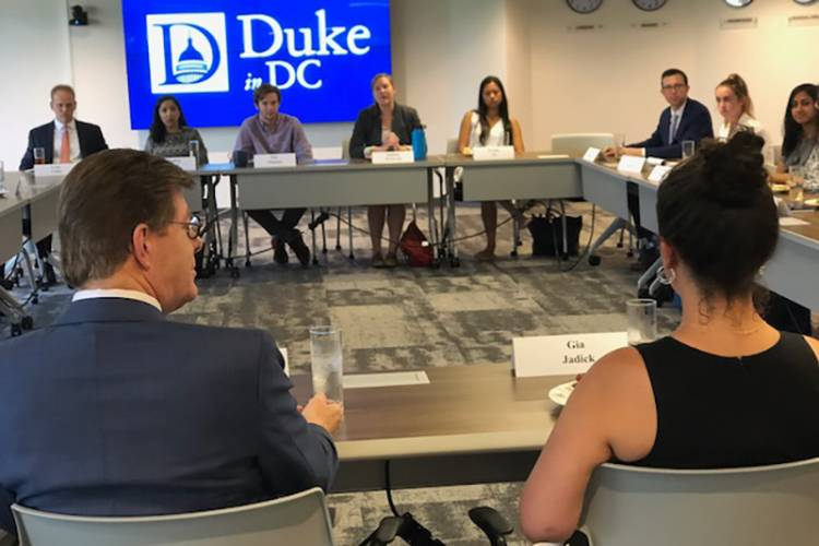 Over dinner, Price talks with Duke Engage students in DC about their work and issues affecting higher education. Photo by Chris Simmons