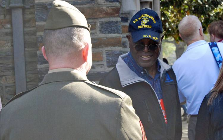 Roland Falana speaks with fellow veterans after Monday's ceremony. Photo by Stephen Schramm.