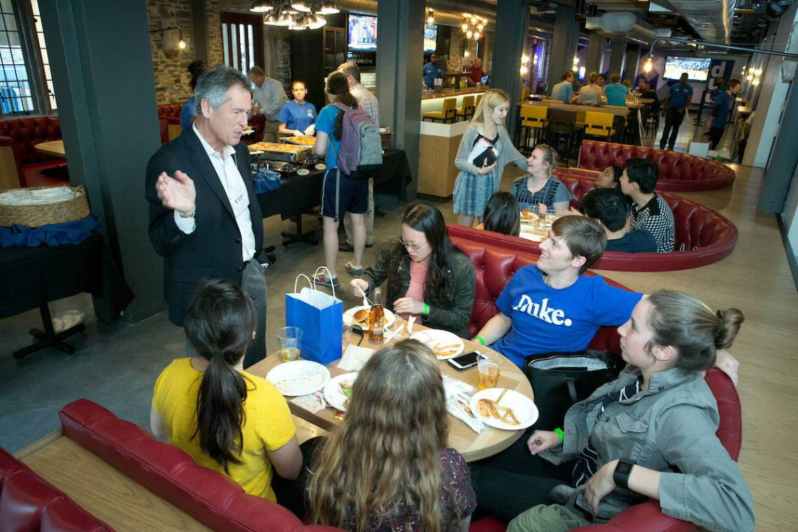 Larry Moneta talks with students in the Devil's Krafthouse in the renovated Brodhead Center, one of the many projects he championed to enhance student life on campus.