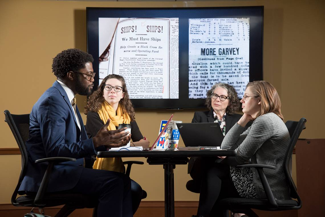"The English department launched a pilot lab for the Humanities Unbounded grant proposal, ""Representing Migration."" Shown are lab members English Professors Charlotte Sussman and Jarvis McInnis with doctoral student Karen Little and sophomore Liddy Grantla"