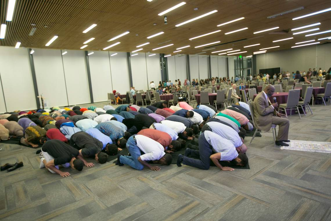 Imam Abdul Waheed, Interim Muslim Chaplain at Duke, far right, leads the prayer during the Duke Muslim Students Association's annual Eid Banquet on Saturday evening at Penn Pavilion.