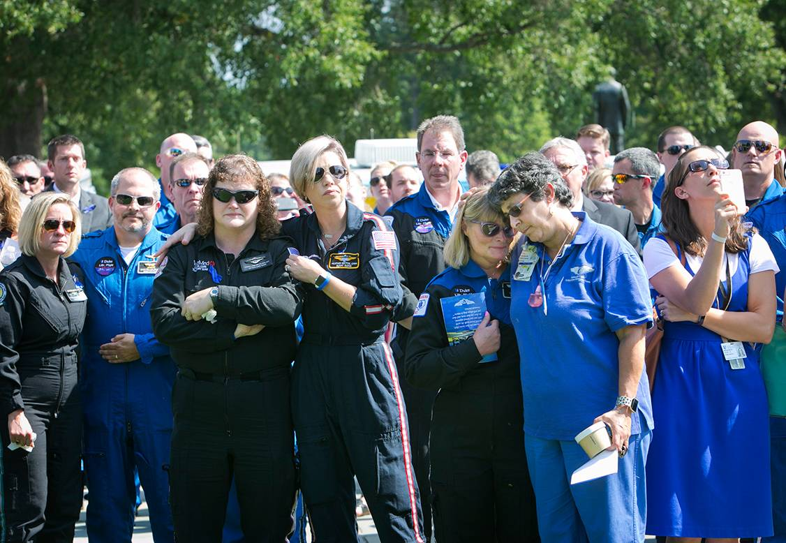 Duke community members and area first responders take a moment before the memorial service Wednesday. Photo by Jared Lazarus/Duke Photography