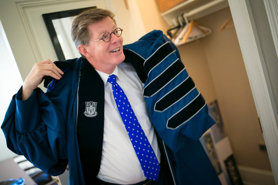 Vince Price gets his robe ready in advance of the inauguration. Photo by Duke Photography