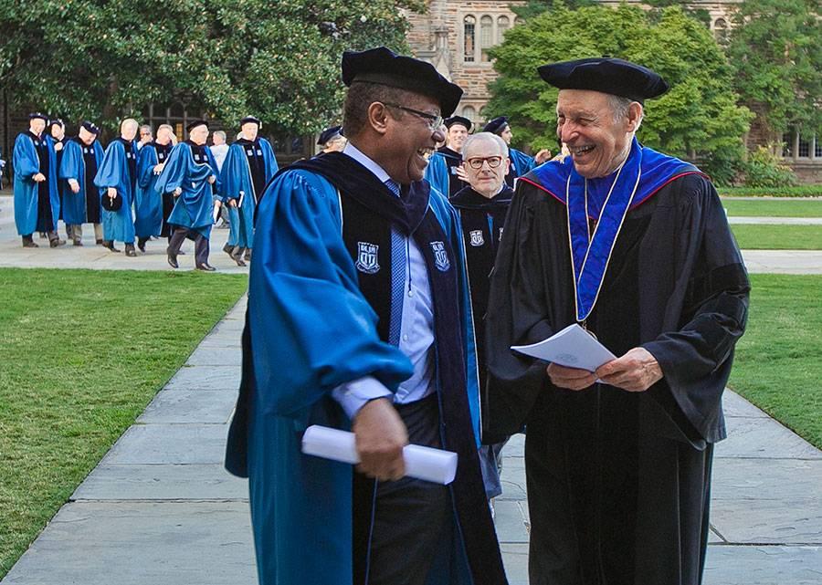 Horst Meyer talks with Duke Trustee Daniel Blue Jr. before the 2014 Founders' Day ceremony. Photo: Duke Photography