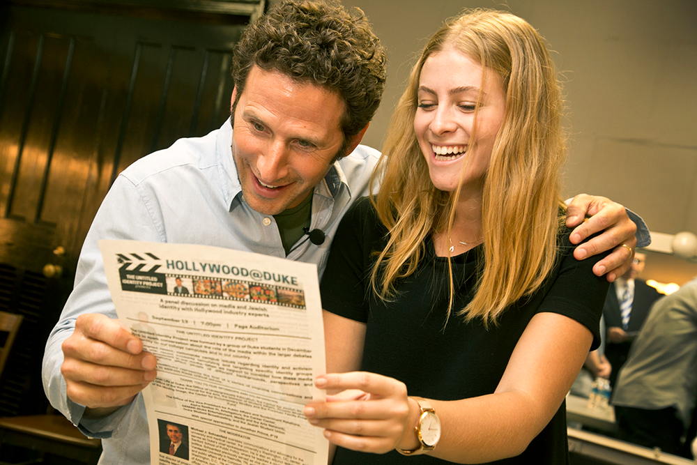 Actor Mark Feuerstein hams it up with sophomore Elizabeth Byrnes-Mandelbaum prior to the panel discussion