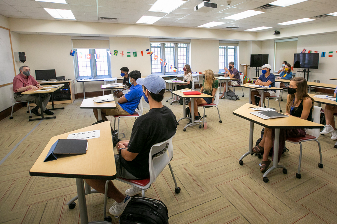 Professor Michael Newcity leads a FOCUS class in a room where the students have been set apart.