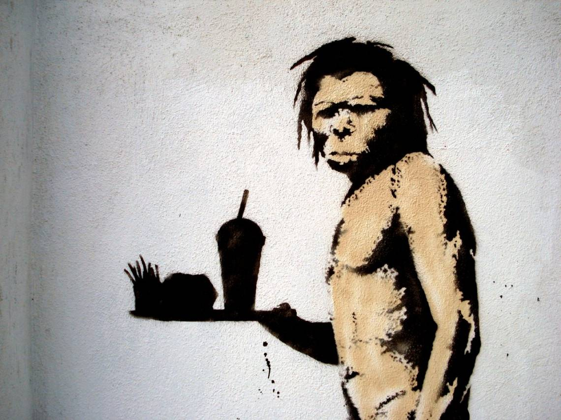 Caveman with fast food by Banksy. Licensed under CC BY 2.0. Source: Lord Jim https://www.flickr.com/photos/lord-jim/2245362817