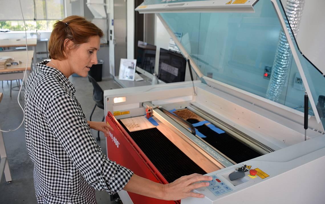 Raquel Salvatella de Prada uses the laser cutter in the Rubenstein Arts Center makerspace to create an art installation. Photo by Jonathan Black.