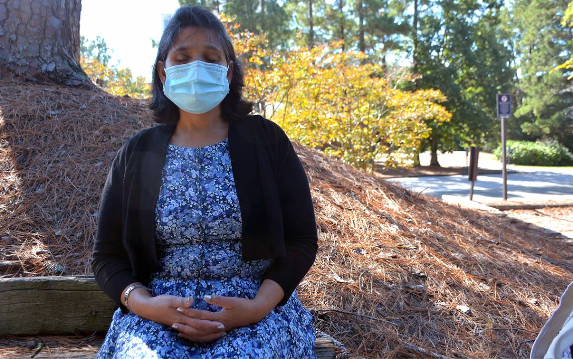 Arunima Srivastava performs her deep breathing exercise outside of the Duke Lifestyle and Weight Management Center. Photo by Jonathan Black.