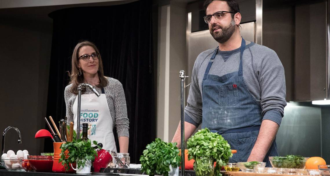 Duke Ph.D graduate Ashley Rose Young and chef Alon Shaya during a cooking demonstration. Photo courtesy of the Smithsonian's National Museum of American History.