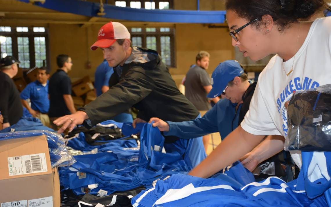 Shoppers check out basketball gear at Friday's Duke Athletics Surplus Sale. Photos by Stephen Schramm.