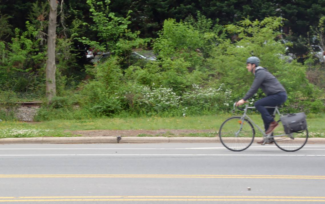 Connor Drake, a research program leader at Duke's Center for Research on Personalized Health Care, rides home from work.