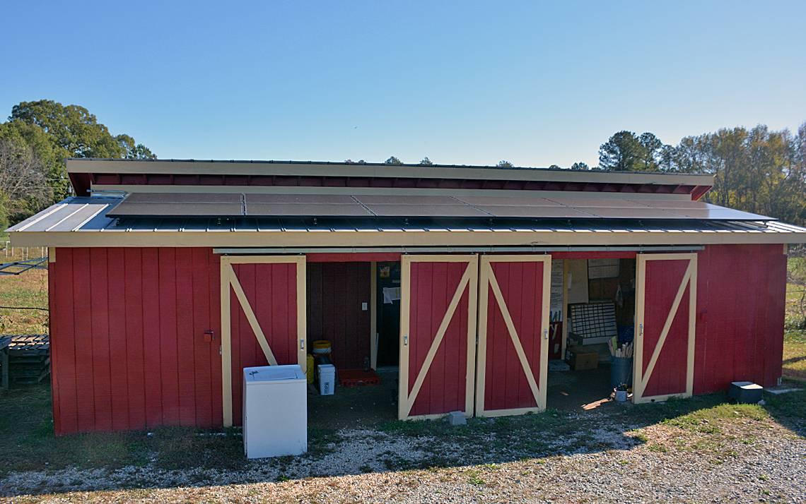 A dozen solar panels line the roof of Duke Campus Farm's barn. Photo by Jonathan Black.