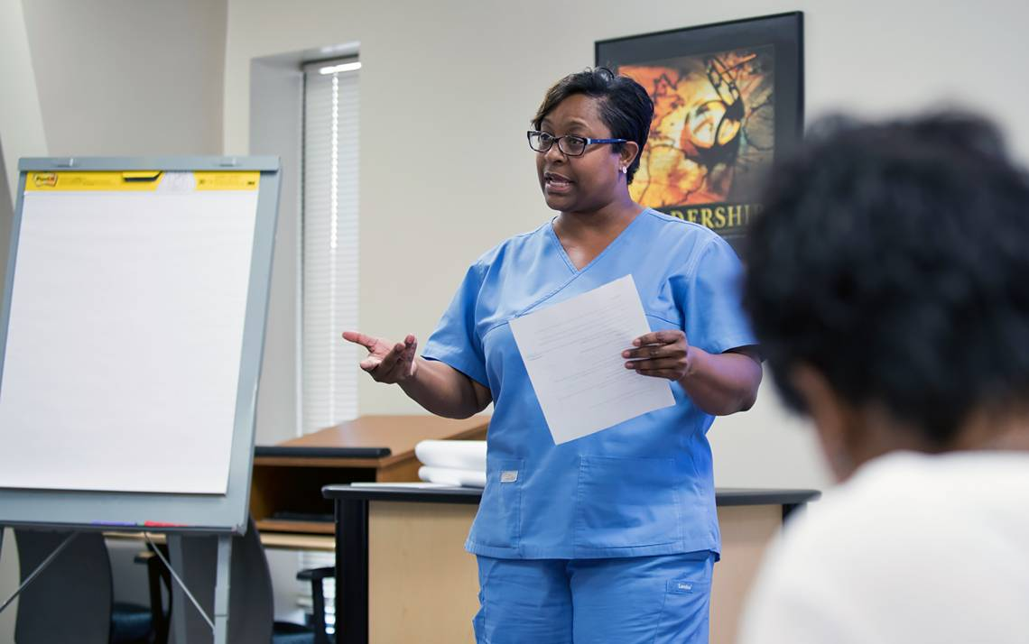 Duke quality assurance technician Karla Washington presents about pharmacy hand hygiene to Duke's Learning & Organization Development classmates.