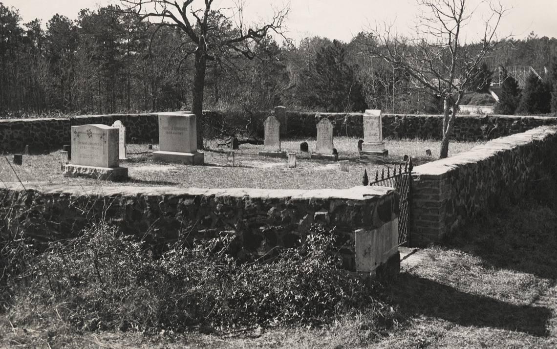 About 17 gravestones dot the quarter acre of land set aside for the Rigsbee Graveyard on Duke's West Campus. Photo courtesy of Duke University Archives.