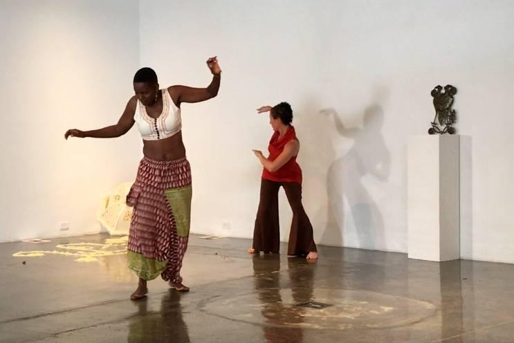 Aya Shabu and Dasha Chapman perform a narrative dance of Durham's history.