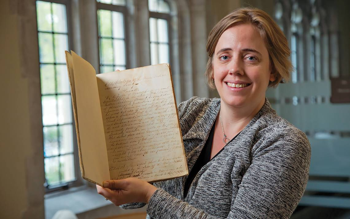 Duke University Archivist Valerie Gillispie holds the constitution of the Union Institute Society. Written in 1839, it is the founding document of the school that later grew into Duke University.