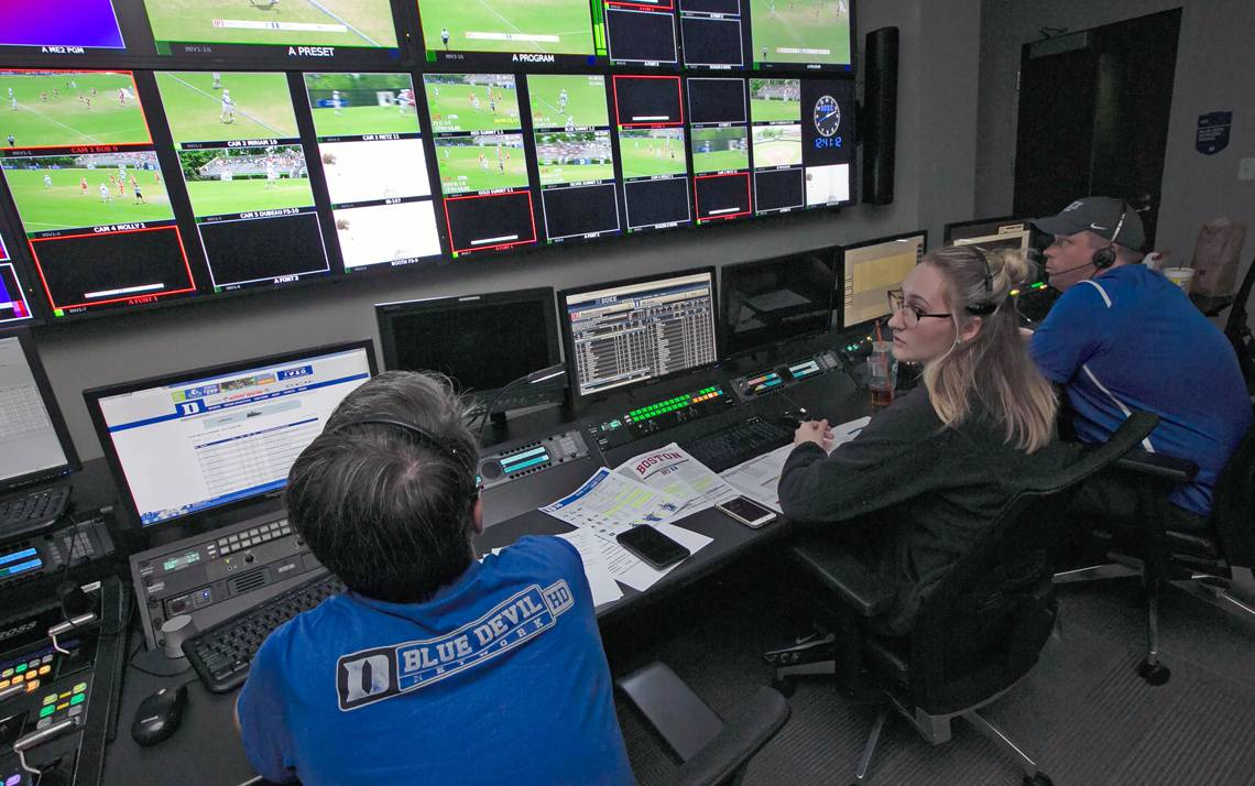 The Blue Devil Network control room is a hive of activity on game day. Photo by Megan Mendenhall.