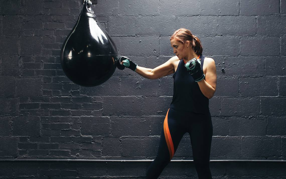 Rachel Meyer boxes at MADabolic gym in Raleigh earlier this year. Photo by Alex Boerner.