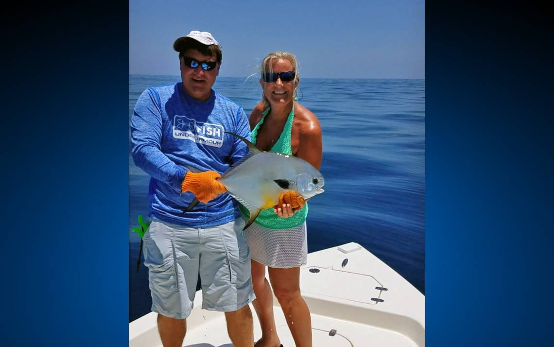 Dot Mishoe, right, holds her prized Permit fish with friend, Robert Miller, in Florida. Photo courtesy of Dot Mishoe.