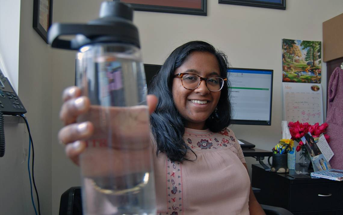 Minoka Gunesekera of the Duke Divinity School shows off her water bottle. Photo by Stephen Schramm.