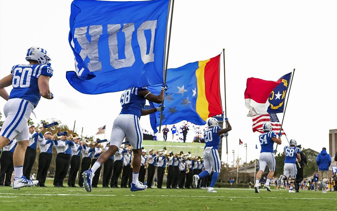 The Duke football team takes the field last season.