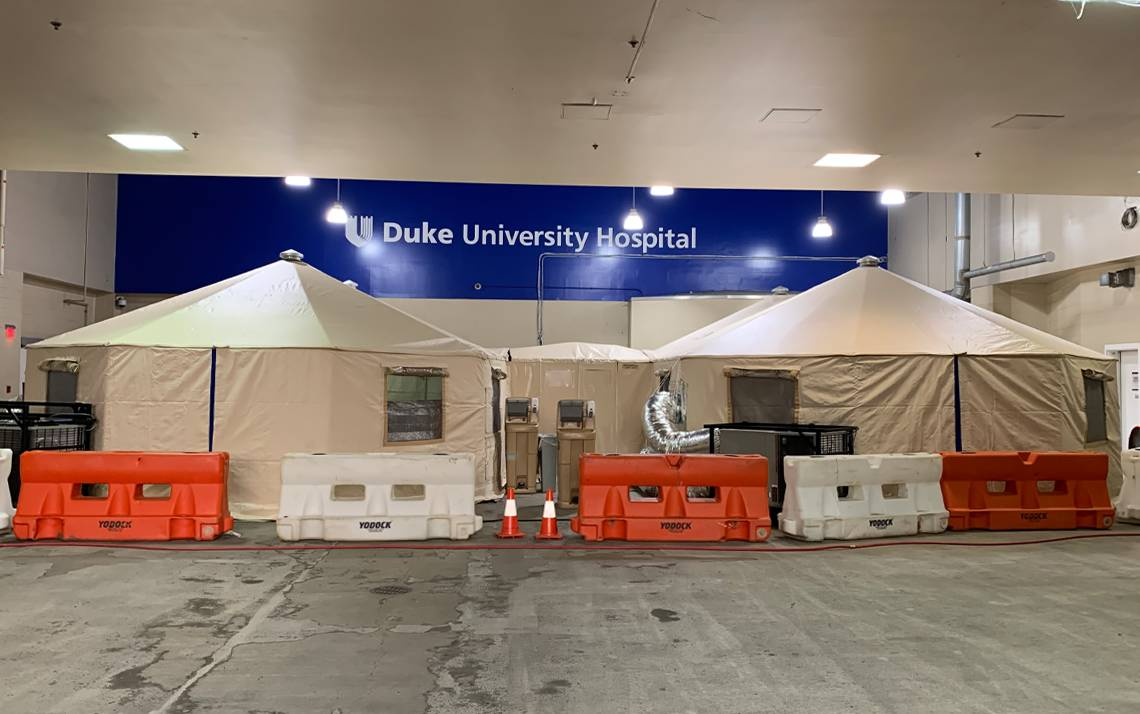 Triage tents are set up in the Duke University Hospital ambulance bay to receive patients experiencing COVID-19 symptoms. Photo courtesy of Jason Zivica.