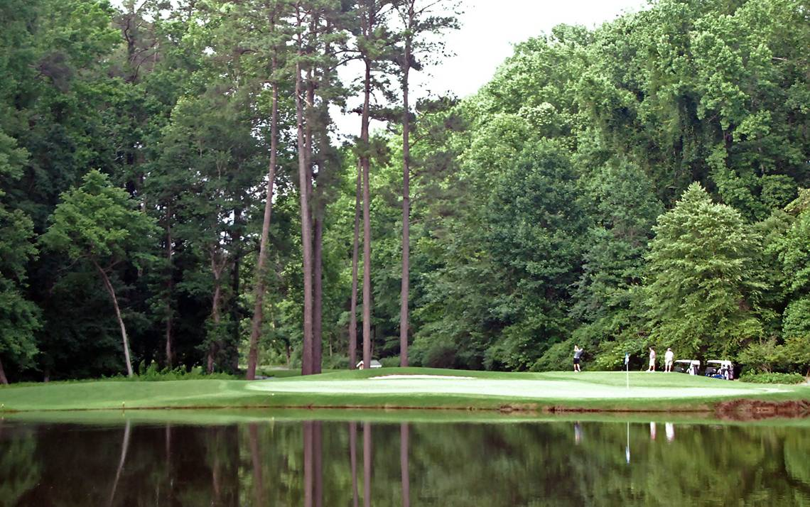 Golfers enjoy an afternoon round at Duke University Golf Club.