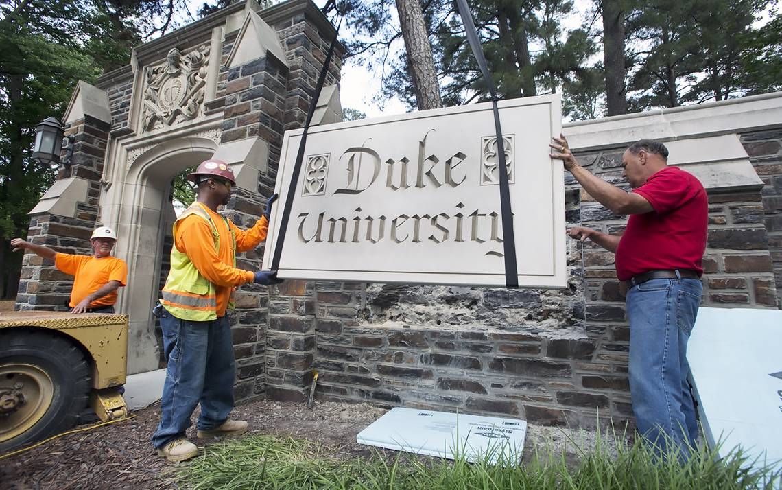 Crews from Carolina Stone Setting insert the 1,100 pound tablet in the wall on Monday. Photo by Chris Hildreth, Duke University Photography.