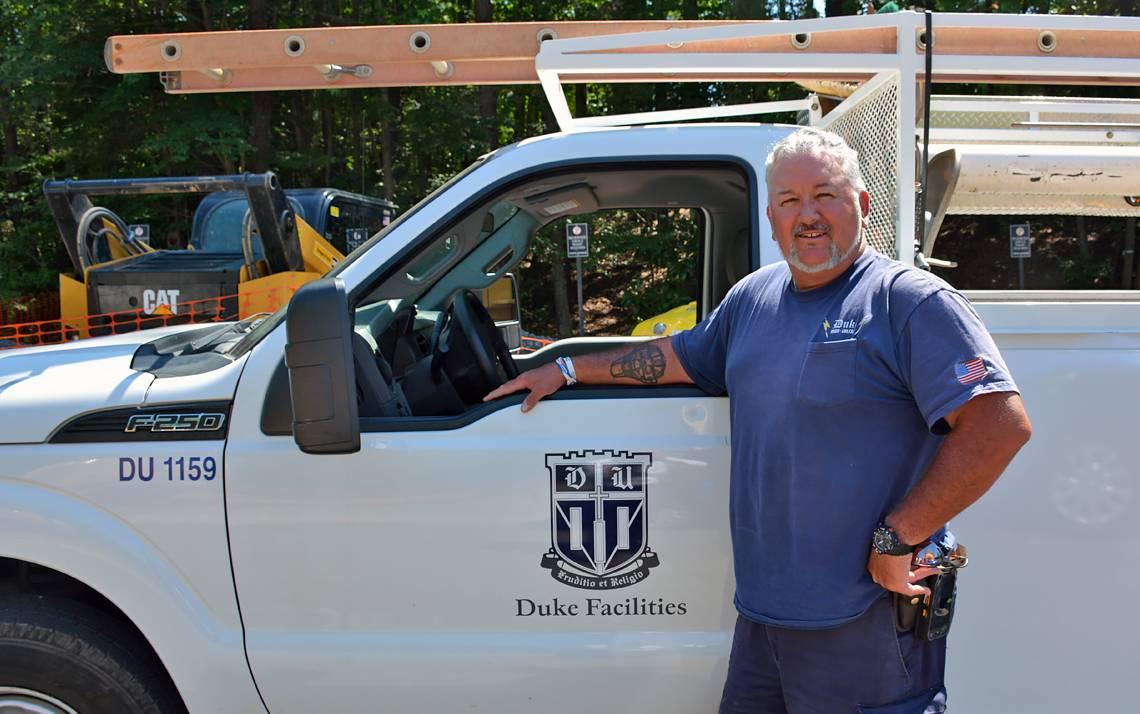 High Voltage Specialist Emmett Dullaghan helps keep the power flowing at Duke. Photo by Stephen Schramm.