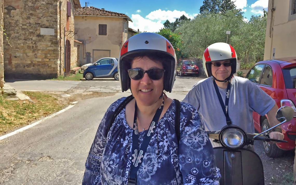 Lisa Eskenazi and her husband Daniel ride Vespas through the Tuscan countryside during a recent vacation in Italy.vacation.