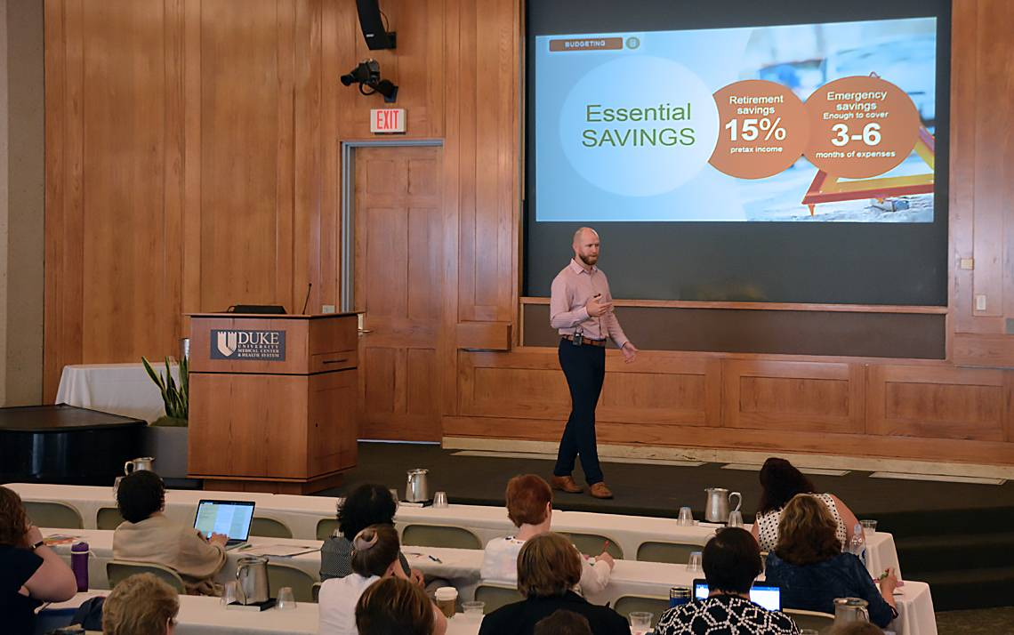 Fidelity Investments financial adviser Alan Collins talks to Financial Fitness Week participants about making a budget.