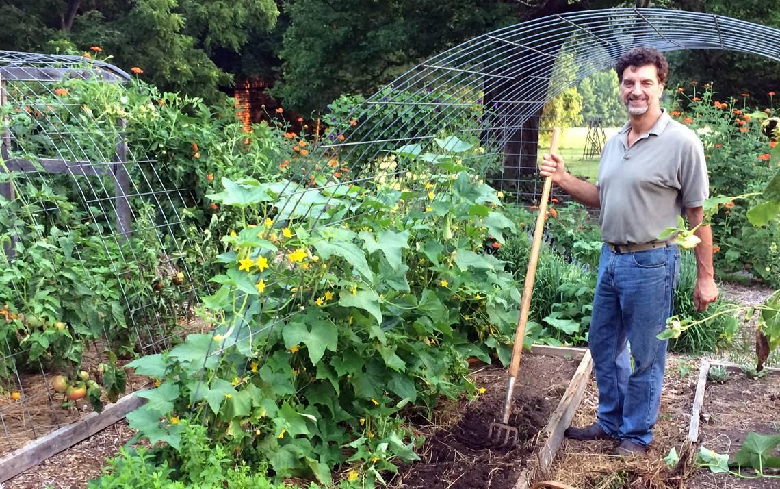 Myron Taschuk works in his home vegetable garden in Orange County.