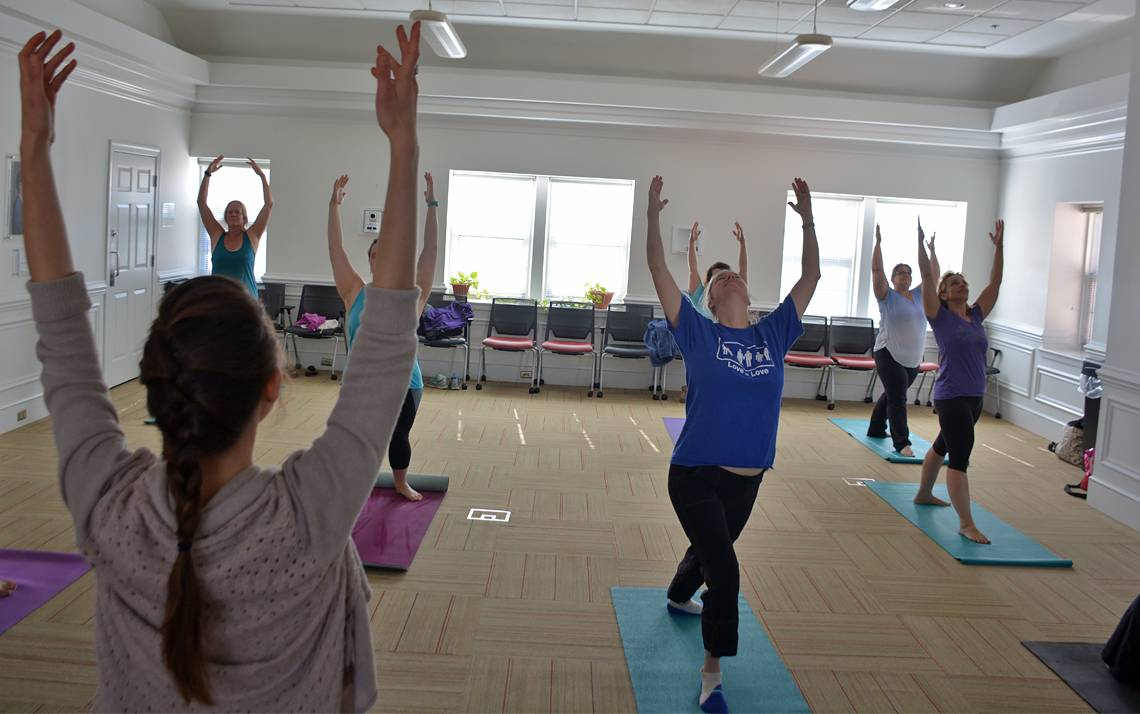 Employees at the John Hope Franklin Center attend a weekly yoga class.