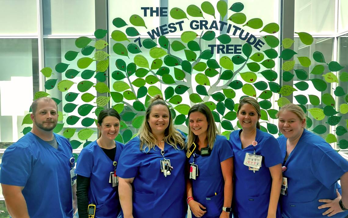 From left to right: Nurses Jason Stokes, Kelsey Collier, Jessica Seabrooks, Ashley Anderholm, Catherine Shuford and Heather Pena, stand in front of the