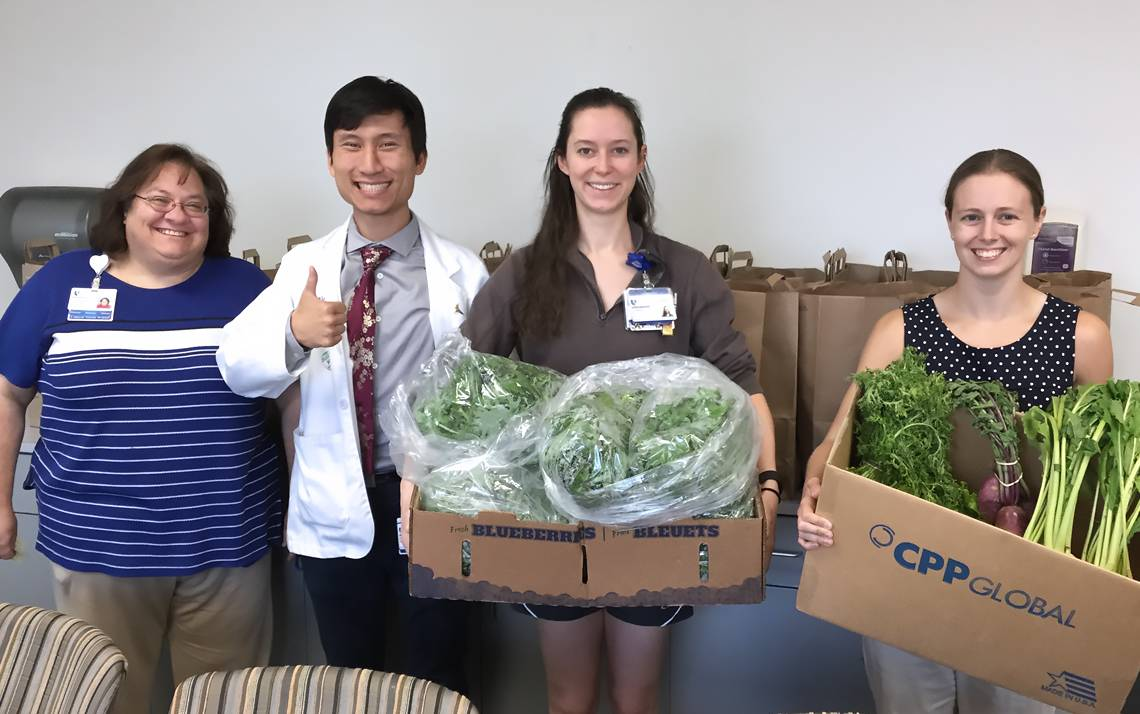 Duke Outpatient Clinic Social Worker Jan Dillard, Duke medical student Julian Xie, Duke Cardiothoracic Surgery Certified Nursing Assistant Lauren Packard, and Duke medical student Amanda Matthews help with the  Duke Outpatient Fresh Produce Program.
