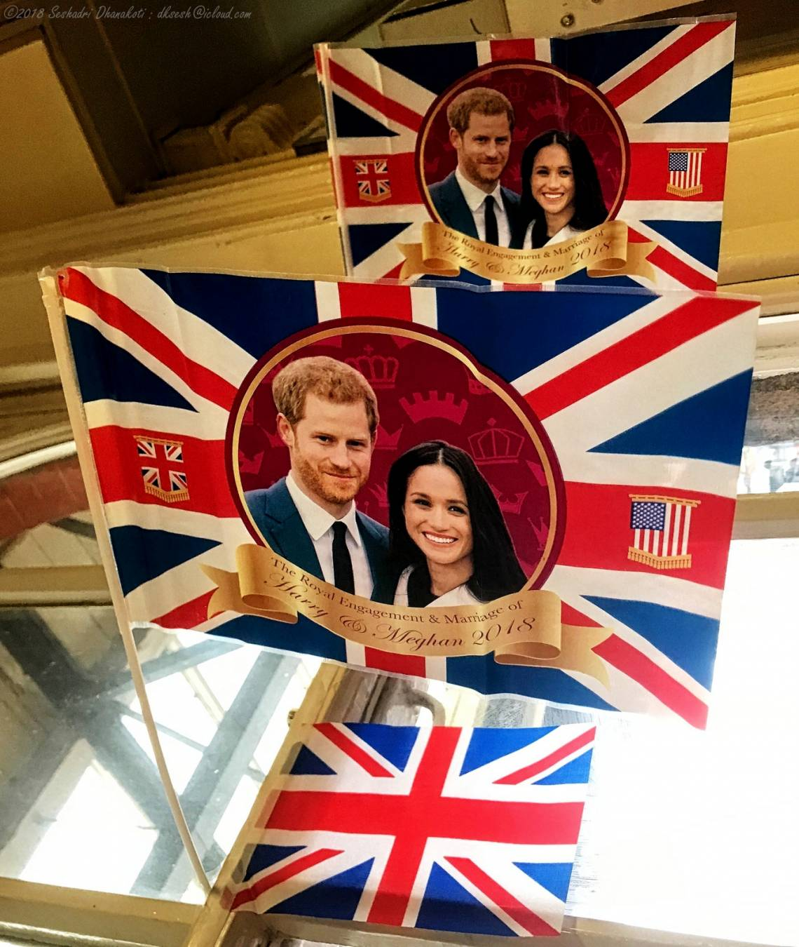 Wedding celebration decorations picturing Meghan Markle and Prince Harry, photographed at Clapham Junction station in London, England.