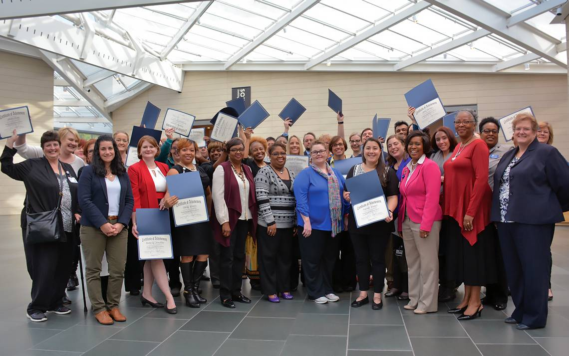 Duke employees celebrate receiving their Excellence certificates through Duke's Learning & Organization Development in 2016.