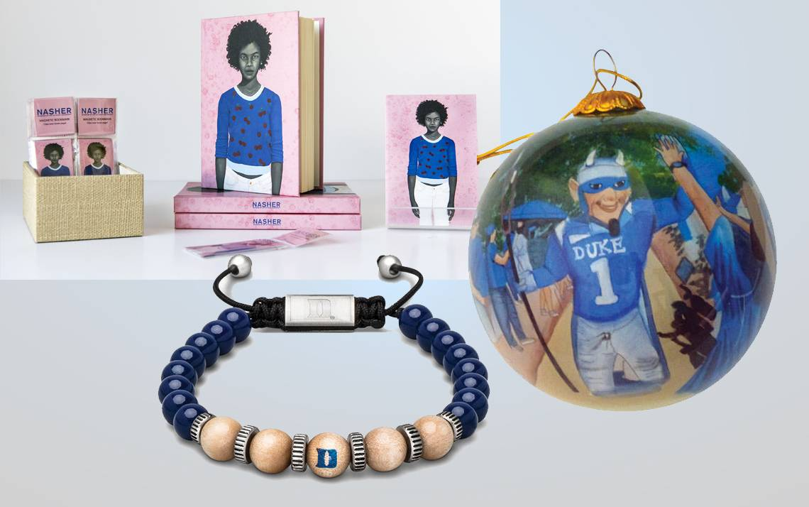 A selection of gifts available from Duke, including books, an hand-painted ornament and a commemorative bracelet.