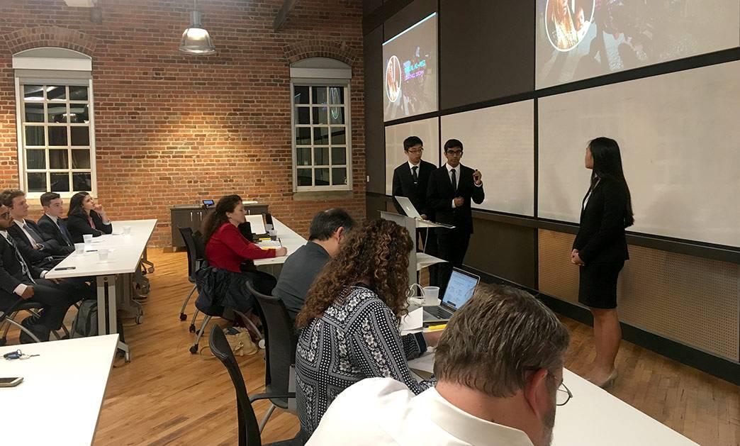 Jason Wang, Saheel Chodavadia and Sherry Feng present their app, Sawiana Enterprises, at the Hult Prize@Duke finals. Photo by Katherine Black