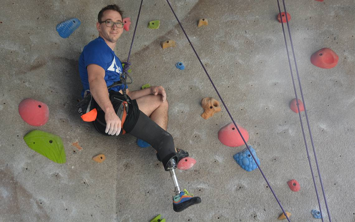 Kyle Long finishes a climb at the Wilson Recreation Center climbing wall. Photos by Jonathan Black.