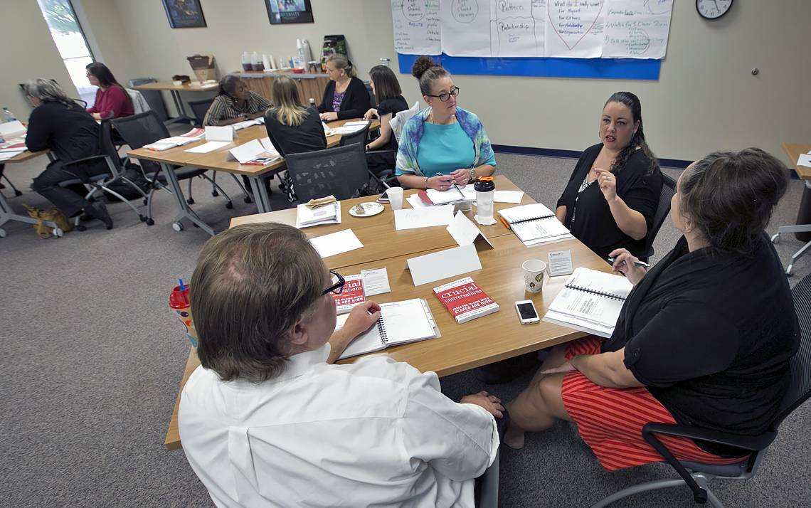 A group takes part in a session of the Crucial Conversations course offered by Duke Learning & Organization Development.
