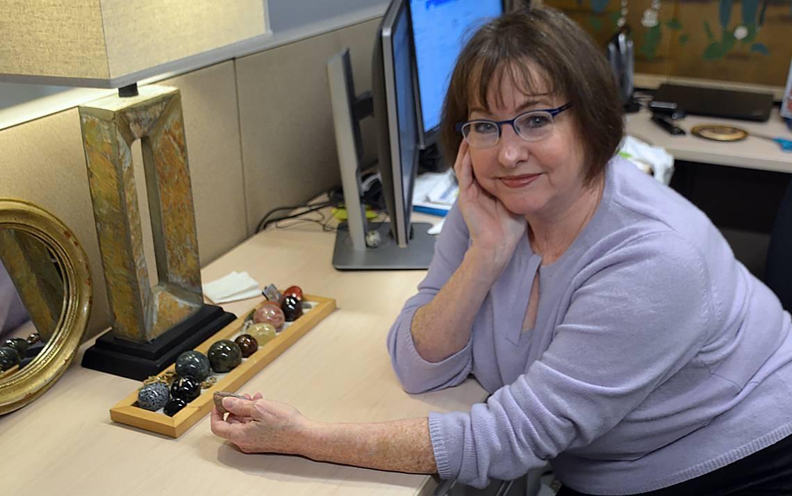 Lisa K. Dilts keeps a collection of gemstones on her desk.