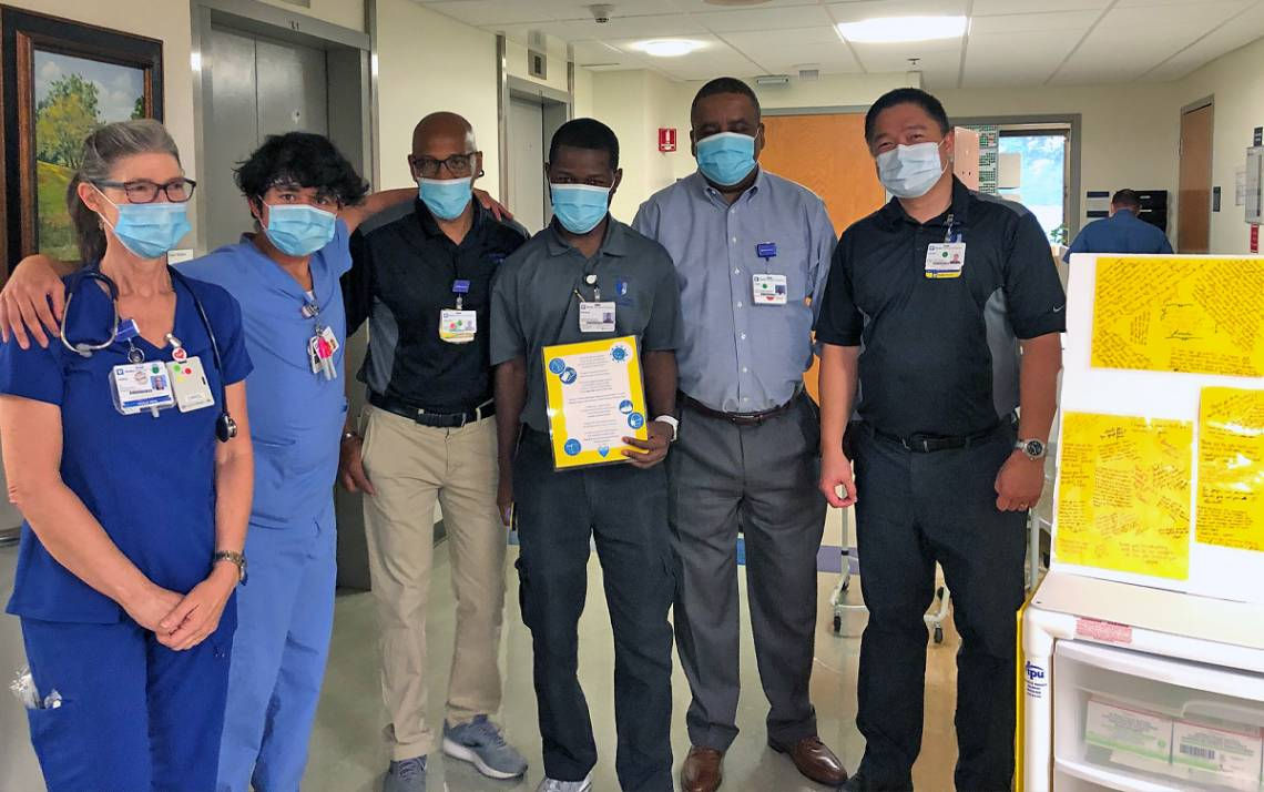 (Left to right) Carol Hobbs and Kai Manu celebrate Duke Raleigh Materials team members Anthony Nobles, Michael Davis, Leon King and Lauro Manahan. Photo courtesy of Duke Raleigh Hospital.